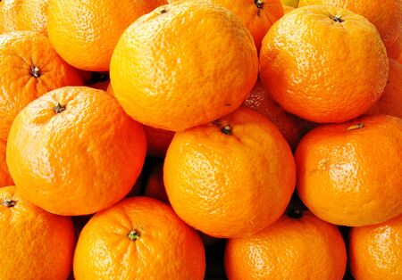 Yellow-dark oranges on the counter market in late summer Stock Photo