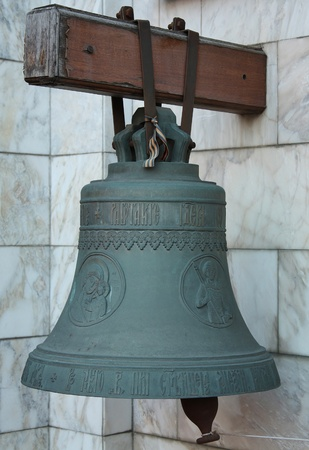 Church bell at the entrance of the Church of St. John the Warrior photo