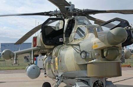 Attack helicopter is armed with rockets, bombs, guns and able to fight day and night