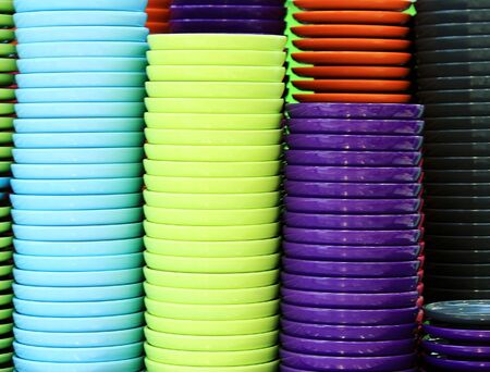 Colorful plates stacked in a pile in a cafe photo