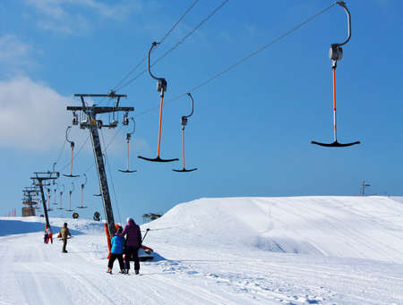 skiers rise to the point of the start of the ski