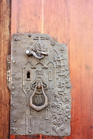 Detail of the door to the ancient building photo