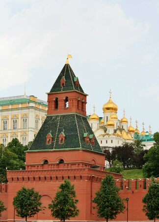 View of wall- and temples� towers of the Kremlin across the ancient red wall photo