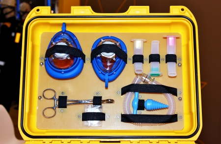Items for artificial breathing and stop bleeding in a suitcase photo