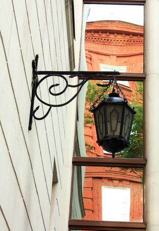 Black vintage lamp decorating the entrance of the building  photo