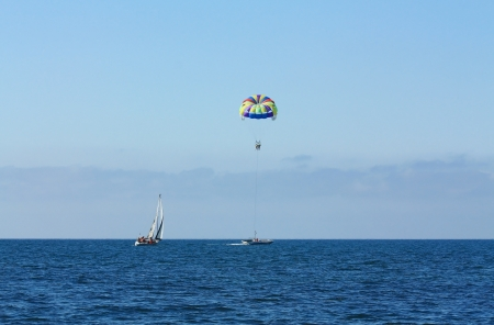 Attraction for tourists on the beach - air travel by parachute