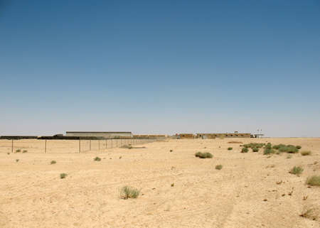 Warehouse of construction goods and temporary construction camps in the sands photo