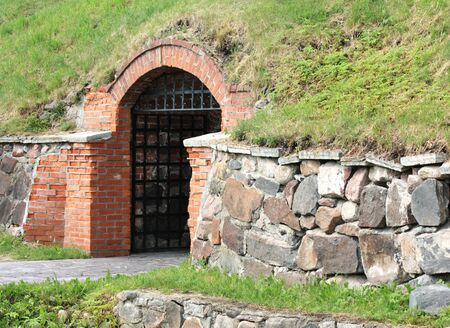 rampart: Entrance to the ancient fortress under the rampart Editorial