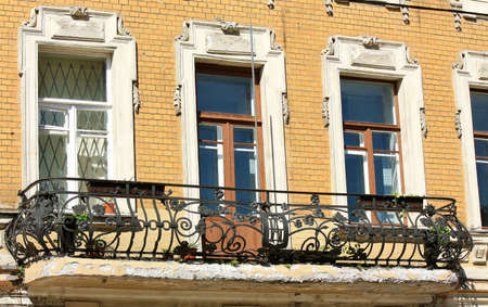 Balcony of dilapidated building in wrought iron photo