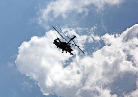 Perform aerobatics by the modern russian attack helicopter Ka-50 at the airshow