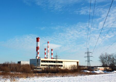 Constructions of a thermal power plant with high pipes and electrical transmission line photo