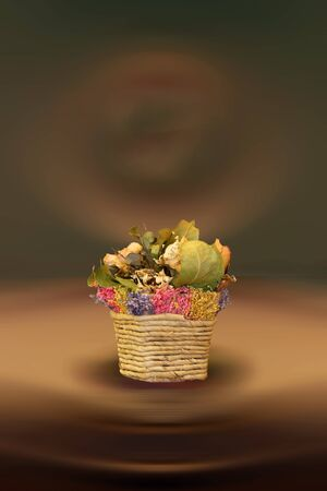 Dried flowers, leaves and plants in a wicker basket photo