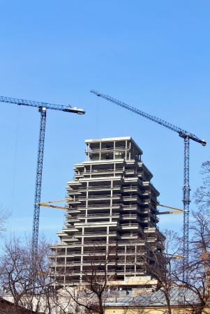 Large-scale construction of the high modern building in town photo