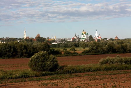 General view of the ancient Russian Kremlin with golden domes of cathedrals and fortress wall towers photo