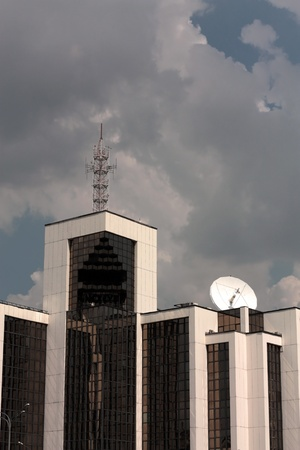 Antenna on the roof of a high-tech building photo