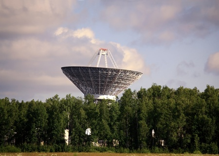 Dish antenna with a metallic reflex reflector in operation Stock Photo