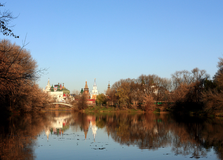 Buildings in the old Russian style on the background of the pond photo