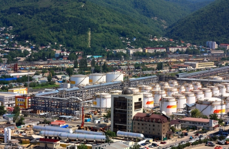 Tanks, pipes, tubes and working facilities of the large refinery Stock Photo