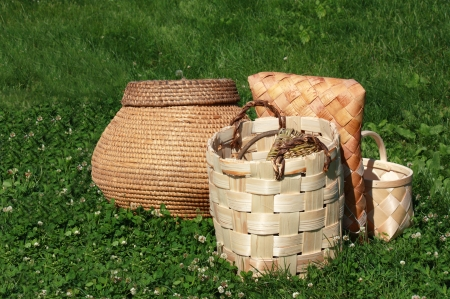 birchen: Wicker baskets and boxes made of birch bark on the green grass Stock Photo