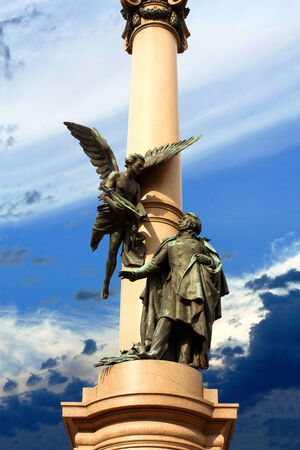 national poet: Monument depicting the poet and the muse down to it Stock Photo