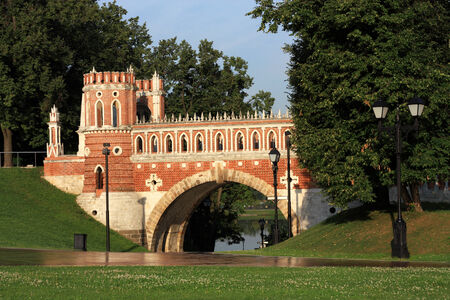 eighteenth: Red brick bridge of the eighteenth century with a tower in the old homestead Russian Tsarina