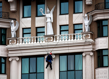 Worker-climber, cleaning the facade of a monumental building Editorial