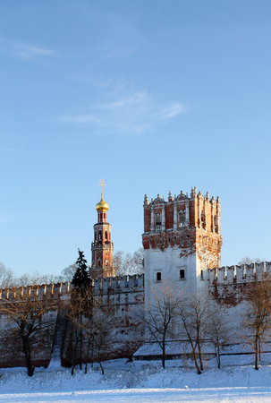 Wall, guard tower and belfry dome of the  Orthodox Novodevichy Convent in Moscow Stock Photo - 25092469