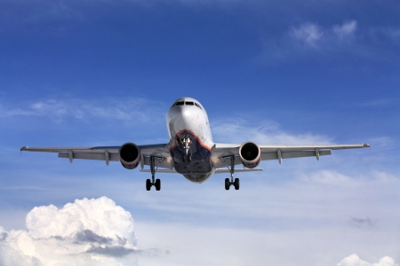 Large passenger jet plane during descent just before landing Stock Photo