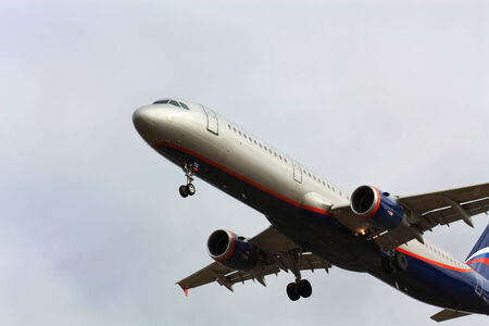 off ramp: Large passenger jet plane gaining altitude after take-off Editorial