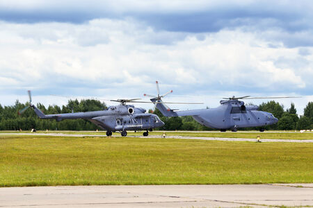 Modern russian military transport helicopters taking off photo