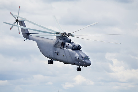 Modern russian military transport helicopter in flight photo