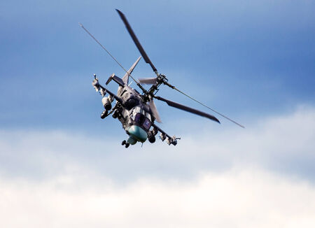 KA: Flight ofy the modern russian attack helicopter in the blue sky