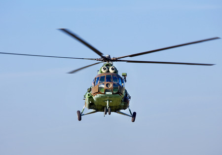 mi: Russian military transport helicopter Mi 8 in flight Stock Photo
