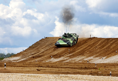 Infantry combat vehicle on a march over rough terrain photo
