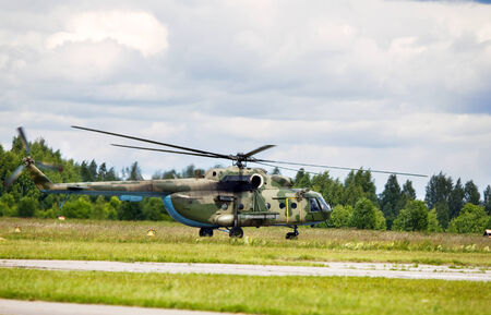 Modern russian military transport helicopter on the parking place photo