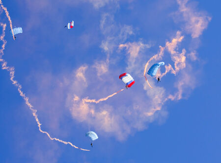 paradglider: Skydivers descend by colored parachutes at high altitude