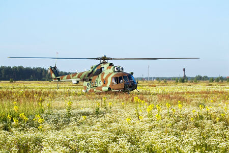 Modern russian military transport helicopter taking off photo