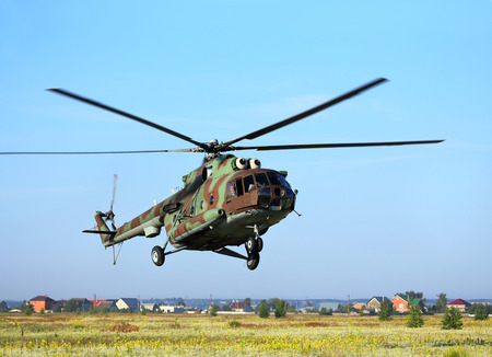 aircrew: Modern russian military transport helicopter in flight Stock Photo