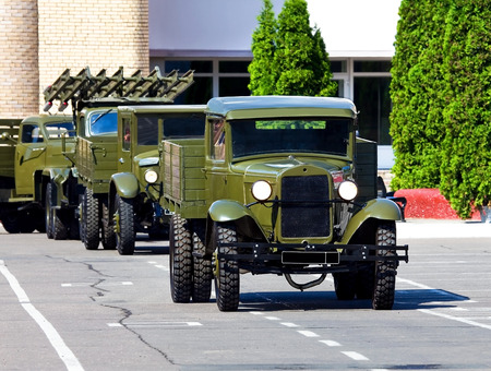 Military argo truck of the old model   equipped for the transportation of people