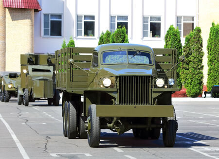 Military �argo truck of the old model   equipped for the transportation of people