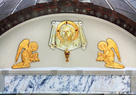 Spiritual symbols  at the entrance to the orthodox cathedral photo