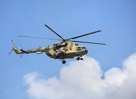 Modern russian military transport helicopter in flight Stock Photo