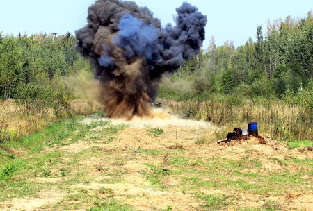 Explosion during demining using miner-robot Stock Photo