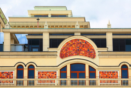 Facade of a massive building with galleries and balconies photo