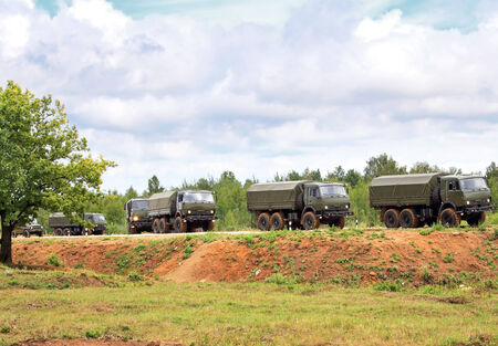 Unit of military vehicles for the transport of personnel on the march photo