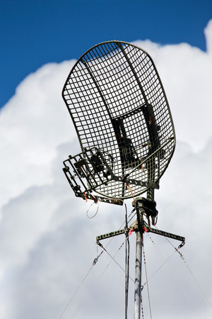airwaves: Metallic antenna on the background of white clouds