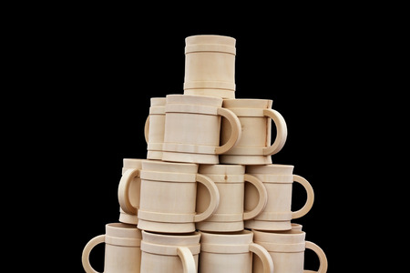 steins: Pyramid of wooden white steins on a black background Stock Photo