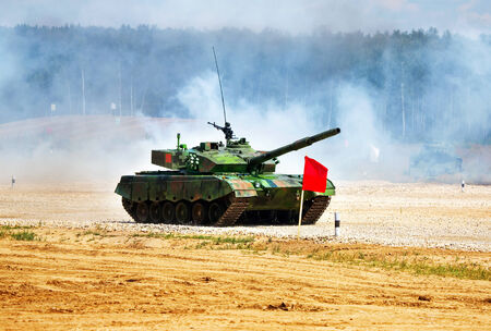 destroyer: Chinese main battle tank on a march over rough terrain