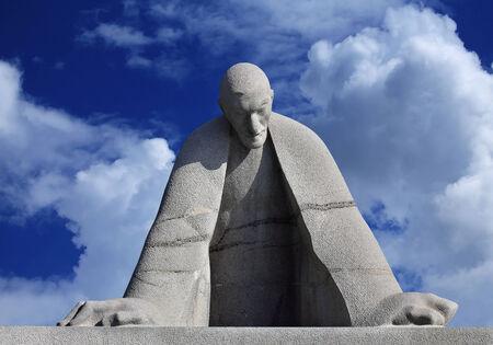 bent over: Sculpture of the prominent armenian architect Alexander Tamanyan bent over drawings Editorial