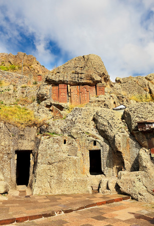 yerevan: Ancient monastery stone wall on the background of rock Stock Photo